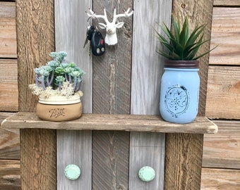 Handmade rustic look wall shelf with deerhead knob