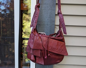 Sarah - a Recycled Soft Leather Messenger Bag in Burgundy Red Leather with Ruffles, Pocket, Zipper and Adjustable Strap
