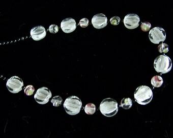 Versatile silver foil and black necklace, bracelet and earrings set