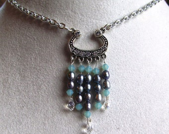 Necklace with Swarovski Focal, Crystals, Blue Freshwater Rice Pearls and Briolettes