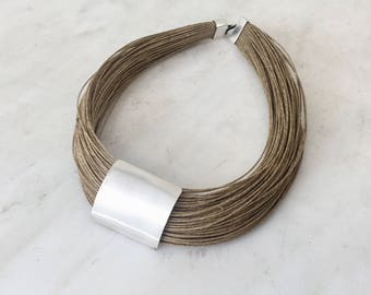 Choker necklace, fine silver,linen rope, handmade item,signed at the back side.Statement jewelry