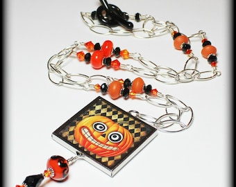 Jack O' Lantern... Handmade Jewelry Necklace Beaded Lampwork Crystal Halloween Orange Black Silver Long Chain Pendant Reversable Goth Retro