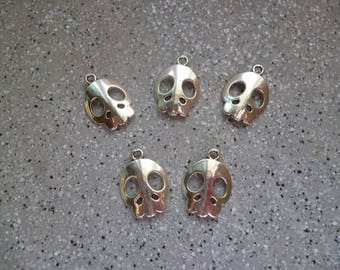 5 charms skulls, skull silver metal