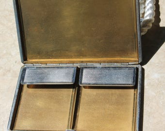 Cigarette Case. Vintage and Silver Tone Metal. Blank cartouche to front. Probably 1970's. Vintage brass cigarette case.