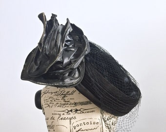 Vintage 60s black pillbox hat/ Whittall & Javits/ giant rosette/ velvet and satin/ Derby party hat/ cocktail party hat