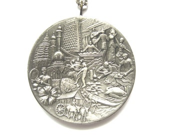 Pewter Pendant Necklace made by Selangor Pewter. Detailed filigree engraved design on front and back.
