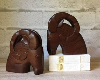 modern rams head bookend pair, mid century vintage dark wood stylized ram book ends, contemporary office library decor, impressively sized