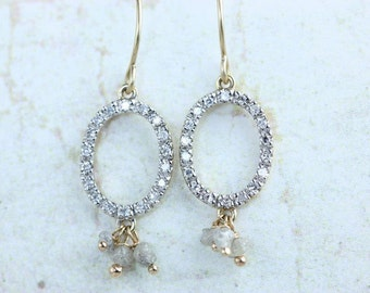 Enchanting oval diamond earrings with raw diamond dangles