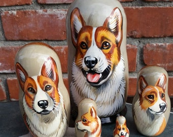 Cardigan Welsh Corgi on Five Russian Nesting Dolls.  Red and White.  Dogs.
