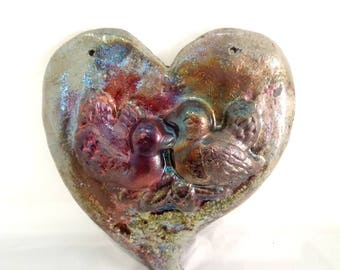 Raku pottery heart with two birds