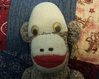 Vintage toy sock monkey with googly eyes