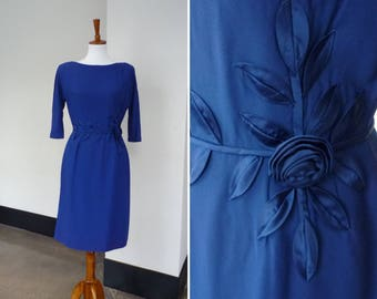 Vintage 50s long sleeve dress in cobalt blue with satin rosette embellishments