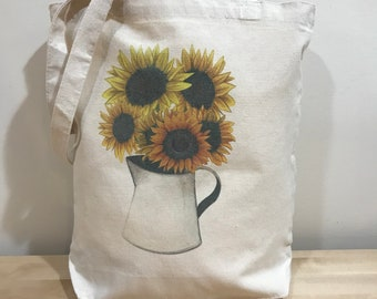 Sunflower in pot tote bag