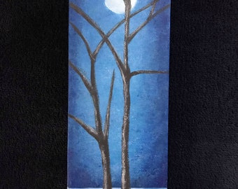 bare trees in the moonlight with brown, blue or green background