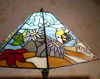 The lamp is stained glass. Stained glass of Tiffany