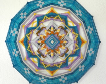 Magic moment, a 24-inch, 12-sided ojo de dios, in stock by by Jay Mohler