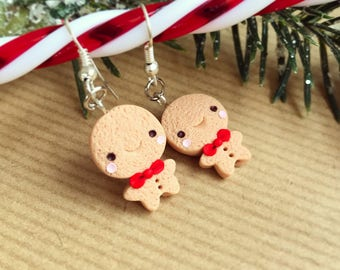 Cute Gingerbread Man Earrings, available in Red or Pink, in a gift box