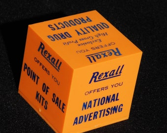 Vintage Rexall Drug Paperweight. Unknown year.