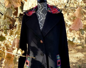 New, wool and cashmere blend Calvin Klein coat accented in Royal Stewart tartan. Size LP