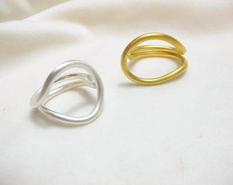 Modern handmade rings in silver and gold.