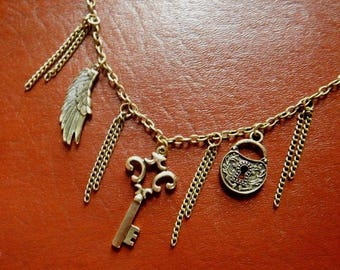 Bronze steampunk necklace with skeleton key, padlock, and bird wing 6I