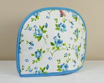 Tea cosy in turquoise flower design