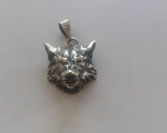Sterling silver wolf Pendant with rubi