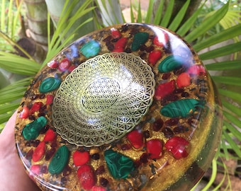 "Ulumāhiehie Festive Orgone Charging Plate with Gold Plated Tube Flower of Life, Malachite, Red Coral, Garnet, Tiger Eye (6"" diameter)"