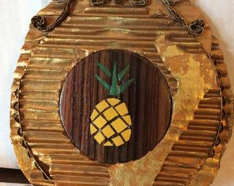 Frame and inlay of wood, pineapple, veneers in a cardboard frame.