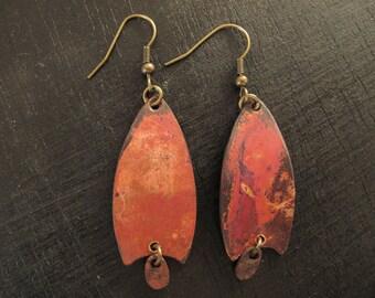 Copper earrings worn