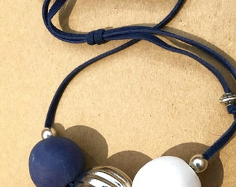 Beaded slip knot necklace with handmade polymer beads