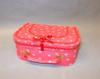 Small suitcase, box a secret,