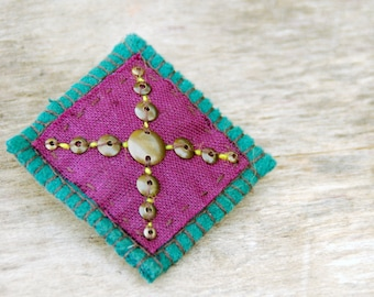 Handmade textile brooch. Purple and teal green brooch with brass beads.