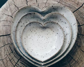 nesting heart bowls in rustic speckled white 4 inches
