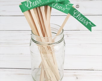 25 Green Drink Stirrer Sticks with Calligraphy Cheers