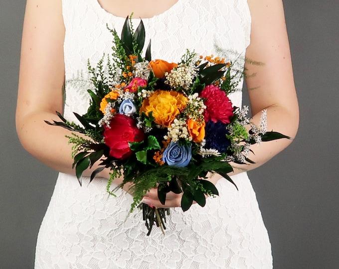 Colorful vibrant wild wedding bouquet yellow orange blue fuchsia pink sola flower boho bridesmaid bouquet preserved greenery