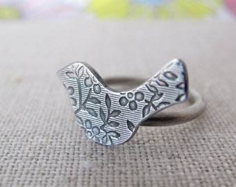 modern bird ring crafted in sterling silver