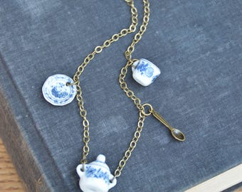 Tea for one. Miniature ceramic tea set charm necklace. Delft, delftware tea themed jewelry