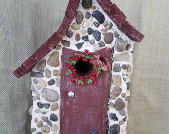 Stone birdhouse with hanger and easy clean out. Coated, durable and made in Michigan.
