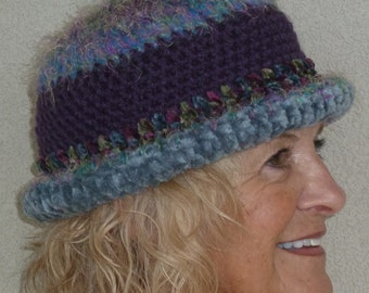 Women's winter hat that is a derby hat, allows for versatile styles, original handcrafted crochet, cute winter hat in blues and purple