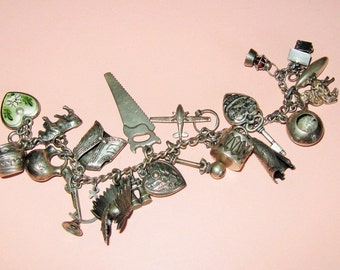 Antique 1940 Sterling  Charm Bracelet 23 Charms-Southwest-Teepee-Drum-Pots-Canoo-Moveable-Headdress-Outhouse-Rifle-Puffy Hearts