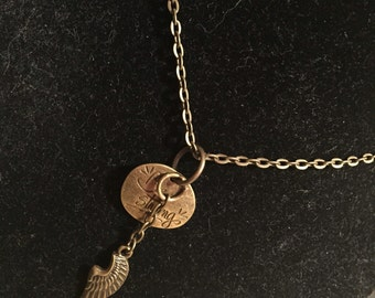 Brass tone angel wing necklace
