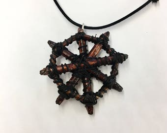 Wheel of pain pendant based on pendant from Conan the barbarian