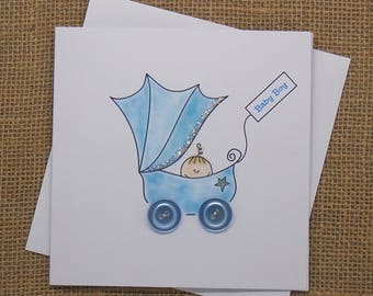 New Baby card for a boy. A cute baby in a pram with button wheels (New Baby, Boy, Personalised, Congratulations, It's a Boy, Baby Shower)