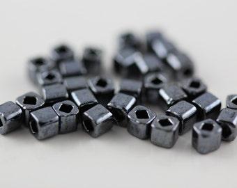 3mm Cube Seed Beads TOHO Metallic Hematite #81  (8 Grams)  (G-5B)