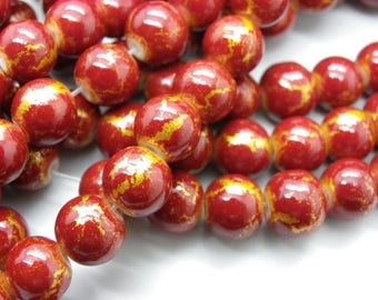 50 glass beads 8 mm painted bomb red with gold