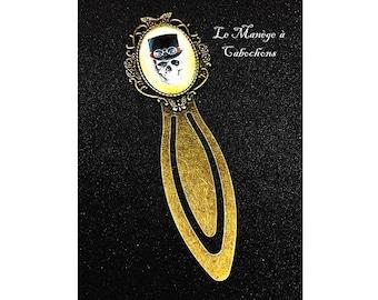 """Bronze bookmark, """"El dia la Muerte"""", glass cabochon."""