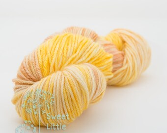 Beautiful hand dyed yellow and light brown hank of DK weight superwash merino wool