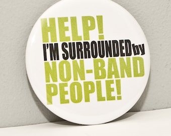 Surrounded by Non Band People -  2.25 inch pinback button or magnet