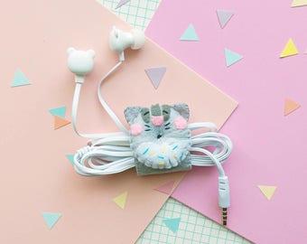 Cat donut earphone organizer with headphones, iphone earbuds, samsung earpods, phone accessories